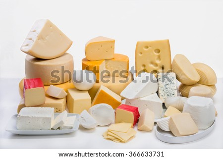 A large variety  of cheeses on an isolated white backgroud