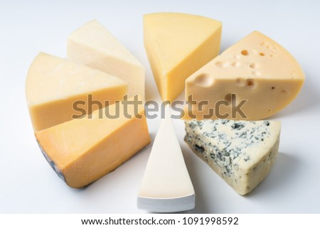 A large variety of cheeses triangles  on an white backgroud #1091998592