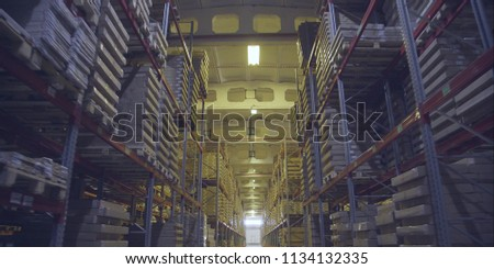 A large warehouse with products from the DCS. Large storage shelves. Warehouse of wooden products. #1134132335