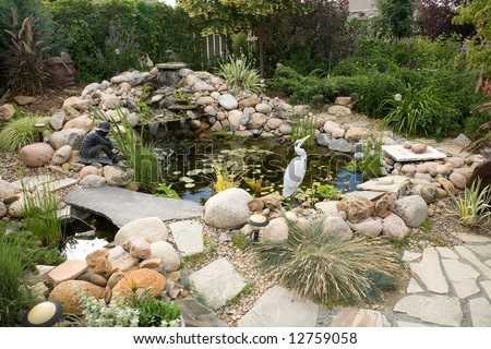 A Large Water Feature Turns A Small Backyard Into A Delightful ...