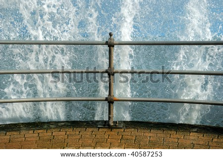 A large wave breaking over the jetty in Swanage, Dorset