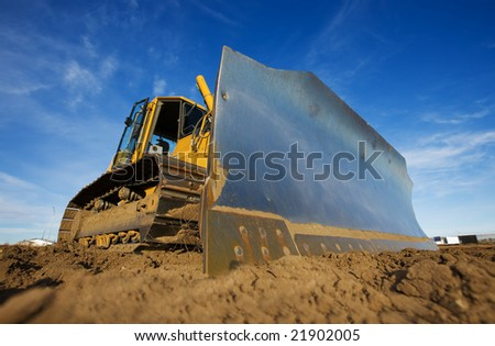 A large yellow bulldozer at a construction site