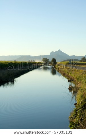 A late afternoon irrigation canal scene adjacent to a Sugar Cane field, near Mt Warning, NSW, Australia