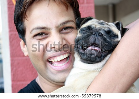 A laughing guy with his PUG pet dog, which also appears to be laughing.