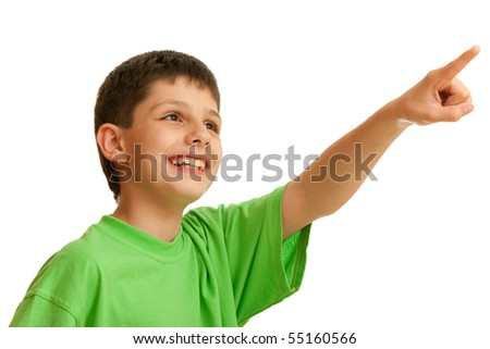 A laughing handsome boy is pointing forward; isolated on the white background
