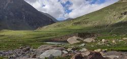 A lavish green piece of land between mountains