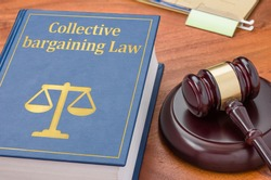 A law book with a gavel  - Collective bargaining Law