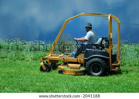 A lawnmower by the lake/pond
