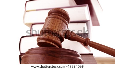 a legal gavel and law books stack
