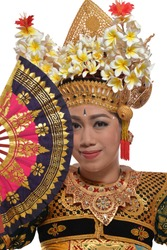 A Legong Dancer Posing at the camera with a fan