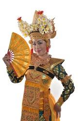 a legong dancer posing with a hand fan