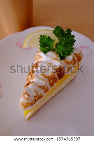 A lemon cake, the creamy sweet mixes with the sour taste.