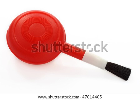 A lens brush blower on white background