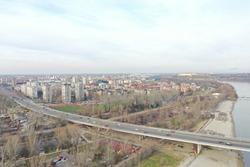 A Liberty bridge over the Danube river and buildings of Novi Sad city in Serbia