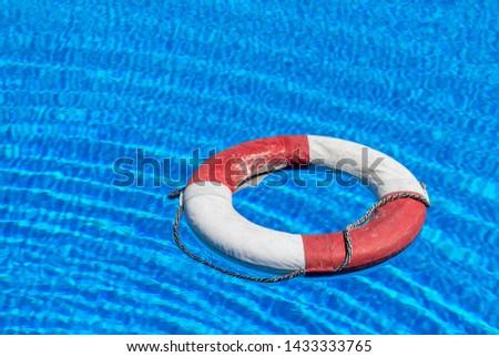 a lifebuoy floats on a pool #1433333765