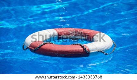 a lifebuoy floats on a pool #1433333768