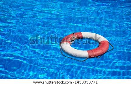 a lifebuoy floats on a pool #1433333771