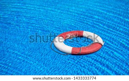 a lifebuoy floats on a pool #1433333774