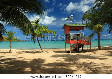 A lifeguard post stands in front of a calm turquoise bay at Seven Seas Beach near Fajardo, Puerto Rico