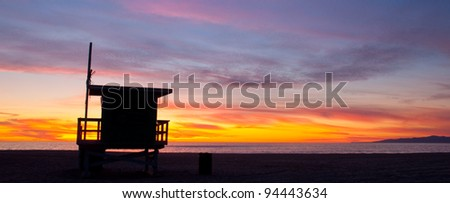 A lifeguard tower at sunset on a beach in Los Angeles, California.