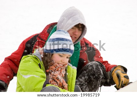 A lifestyle image of two teens snowboarders in winter outdoors