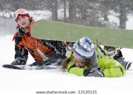 A lifestyle image of two young adult  snowboarders (series Sport, Extreme, Mountains, Teenagers)