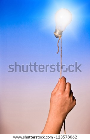 A light bulb floating attached by a rope