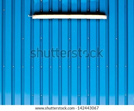 A light bulb on a blue profile cladding