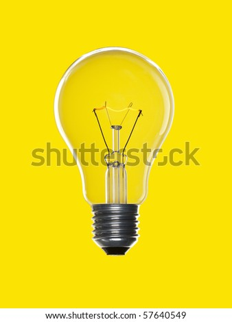 A light bulb over a yellow background. Tungsten glowing filament. - stock photo