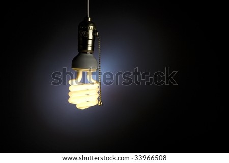 A light bulb with pull chain hanging from the ceiling