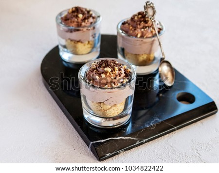 A light dessert of Semifreddo ice cream with whipped cream, cookies and chocolate chips. Vertical. Selective focus.