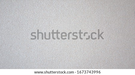 A light gray rough surface is bad from brushed silver metal. Background.