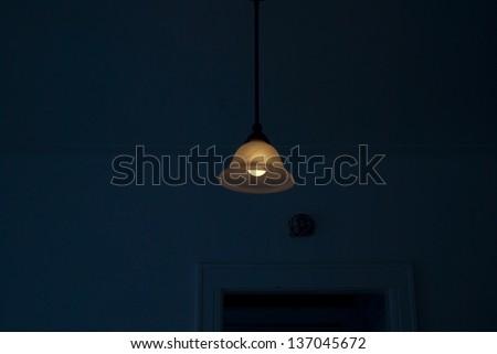 A light peaking through a dark living room