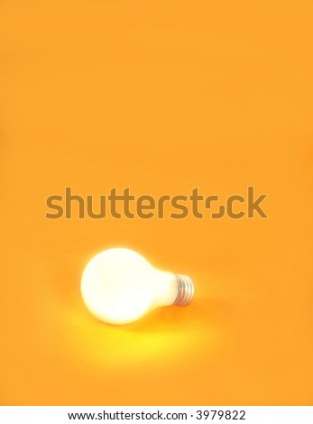 a lightbulb on an orange background - stock photo