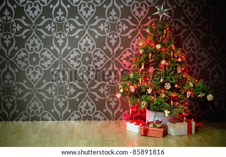 A lighted Christmas tree with presents underneath.