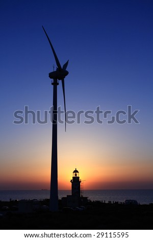 a lighthouse, a wind turbine and a sunset