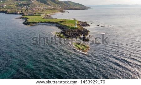 A lighthouse at Cape Jason, Ordu Province, Turkey. Taken by drone (Yason Burnu)  Stok fotoğraf ©