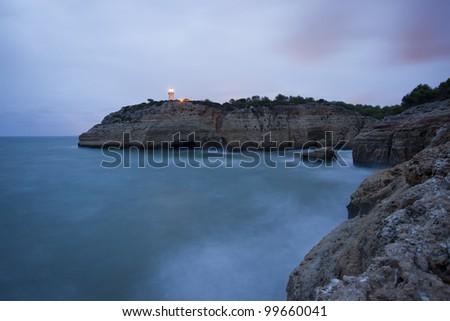 A lighthouse path at dusk.