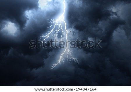 A lightning strike on the cloudy sky