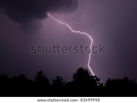 A lightning strike seeks out it target a few milliseconds after leaving the cloud. Picture was taken on August 29, 2011.