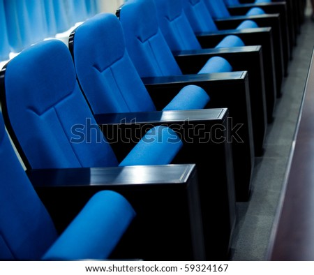 a line of blue theater chairs.