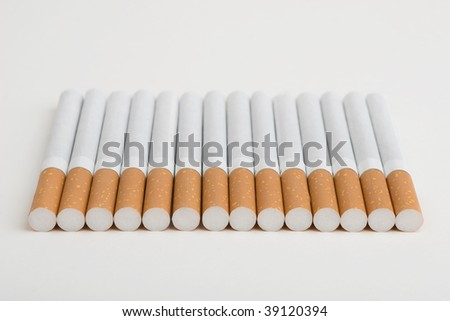 A line of cigarettes isolated on the white
