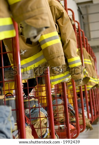 A line of fireman coats await the next call