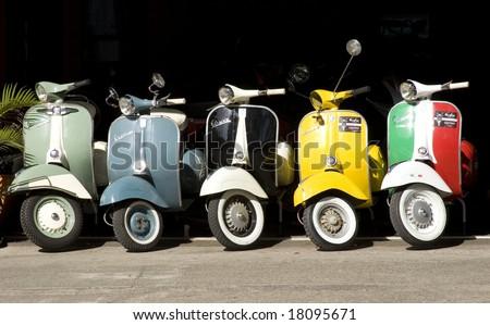 a line of Italian vespas