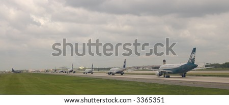 A line of planes ready for take-off in Philadelphia Airport.