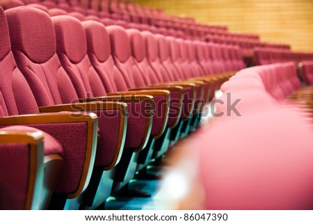 A line of red theatre chairs - short depth of field.