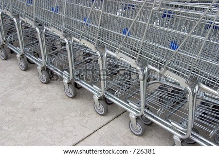 A line of shopping carts nested together. - stock photo