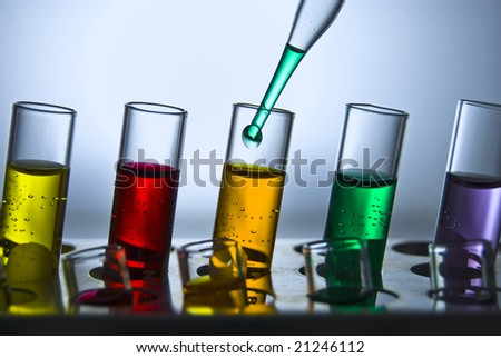 A line of test tubes containing different colored liquids