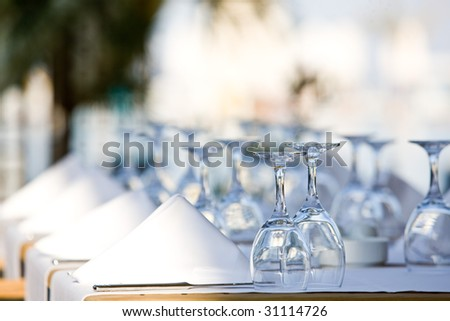 a line of wine glasses fading off in the distance, shallow depth of field.