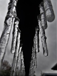 A linear symetrical picture of icicles right after the ice storm in St. Catharines Ontario.  Gives a good aspect of the cold of winter.